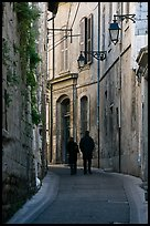 Couple walking in old street. Arles, Provence, France