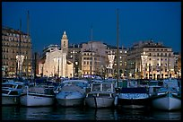 Yachts, church, and city at night, Vieux Port. Marseille, France