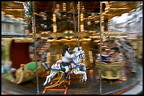 Girl on horse carousel. Avignon, Provence, France (color)