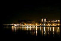 Avignon skyline at night with lights reflected in Rhone River. Avignon, Provence, France (color)