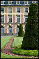 Hedged trees and facade, Palace of Fontainebleau. France