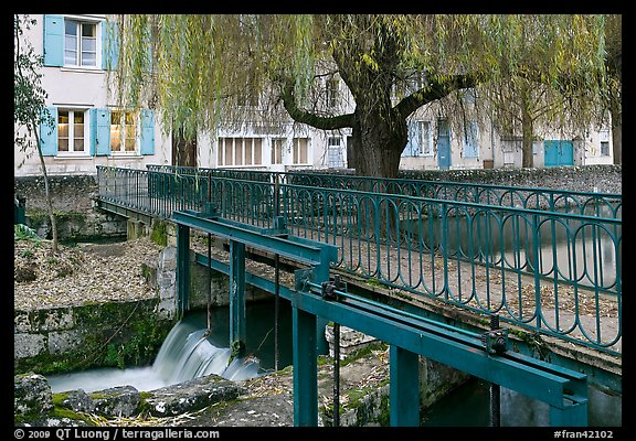 Bridge above canal lock and willow, Chartres. France