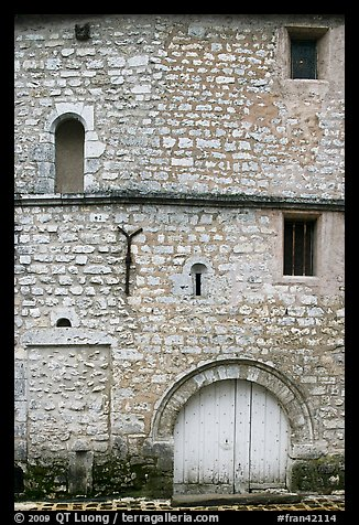 Facade detail of medieval house with small windows, Provins. France (color)