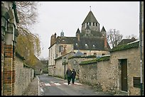 Street with couple walking and Caesar's Tower in background, Provins. France
