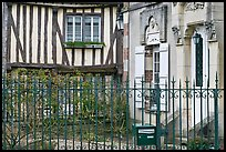 Fence, stone house, and half-timbered house, Provins. France