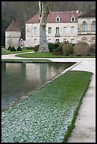 Pond and Abbot's lodging, Fontenay Abbey. Burgundy, France