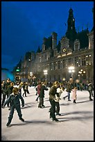 Holiday skaters, Hotel de Ville by night. Paris, France