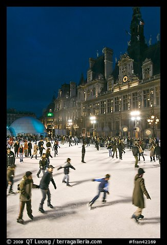 Holiday ice ring, City Hall by night. Paris, France (color)