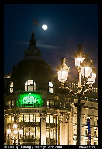 Street lamps, BHV department store, and moon. Paris, France