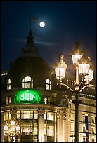 Street lamps, BHV department store, and moon. Paris, France (color)