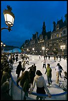 Holiday skating rink at night, City Hall. Paris, France