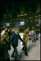 Girls skating by night, Hotel de Ville. Paris, France