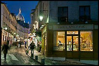 Bakery, street and dome of Sacre-Coeur at twilight, Montmartre. Paris, France ( color)