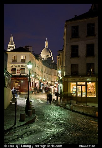 Street and Sacre-Coeur dome at night, Montmartre. Paris, France (color)