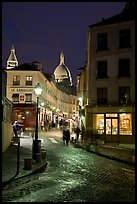 Street and Sacre-Coeur dome at night, Montmartre. Paris, France