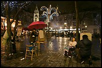 Place du Tertre by night with Christmas lights, Montmartre. Paris, France (color)