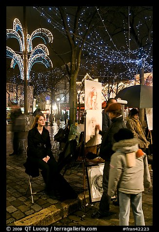 Portraitist at work, Place du Tertre, Montmartre. Paris, France (color)