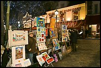 Art for sale on Place du Tertre at night, Montmartre. Paris, France (color)