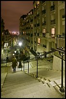 Woman on stairs by night, Montmartre. Paris, France (color)