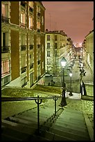 Stairs and street lamps by night, Butte Montmartre. Paris, France