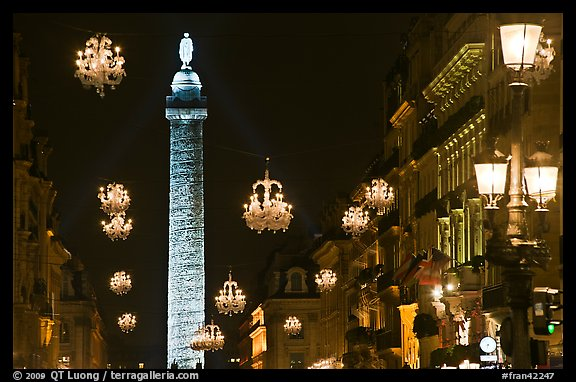 Christmas lights and Place Vendome column by night. Paris, France (color)