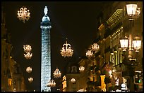 Christmas lights and Place Vendome column by night. Paris, France