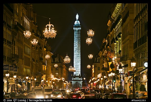 Street with lights and Place Vendome column. Paris, France (color)