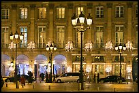 Lights and palace-like classical fronts of Hotel Ritz by Jules Hardouin-Mansart. Paris, France