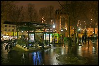 Public square on rainy night. Paris, France