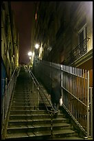 Woman climbing steep steps to the Butte, Montmartre. Paris, France