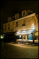 Houses with restaurant at street level, Montmartre. Paris, France