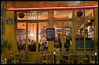 Popular cafe restaurant by night. Paris, France (color)
