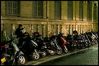 Scooters parked on a sidewalk at night. Paris, France ( color)