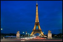 Eiffel Tower seen across Iena Bridge at night. Paris, France