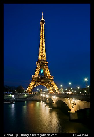 Seine River, Iena Bridge, and illuminated Eiffel Tower. Paris, France