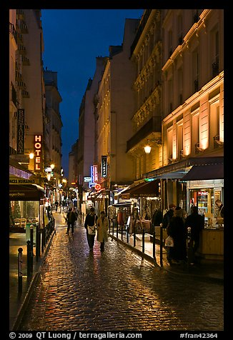 Pedestrian street with restaurants at night. Quartier Latin, Paris, France (color)