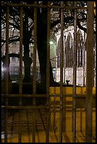 Cluny thermes behind iron grids by night. Quartier Latin, Paris, France