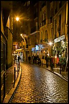 Cobblestone street with restaurants by night. Quartier Latin, Paris, France ( color)