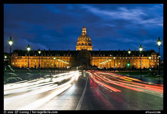 Les Invalides hospital and chapel dome with light trails from traffic. Paris, France