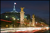 Petit Palais and trafic across Alexandre III bridge by night. Paris, France