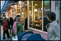 Customers wait in line in front of a popular bakery. Paris, France ( color)