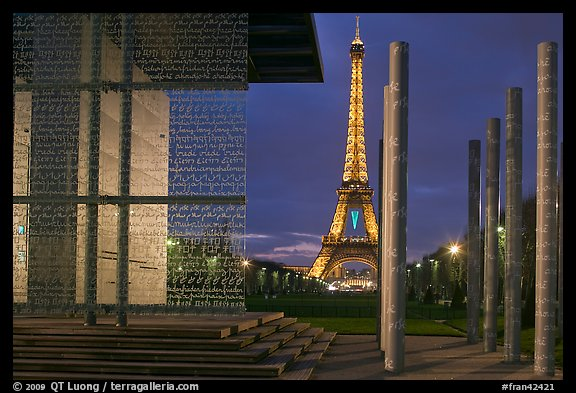 Peace monument and Eiffel Tower by night. Paris, France (color)