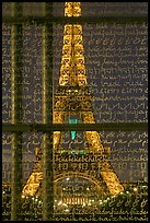 Illuminated Eiffel Tower seen through peace memorial. Paris, France (color)
