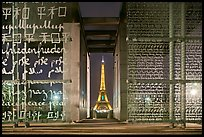 Monument to Peace framing the Eiffel Tower at night. Paris, France (color)
