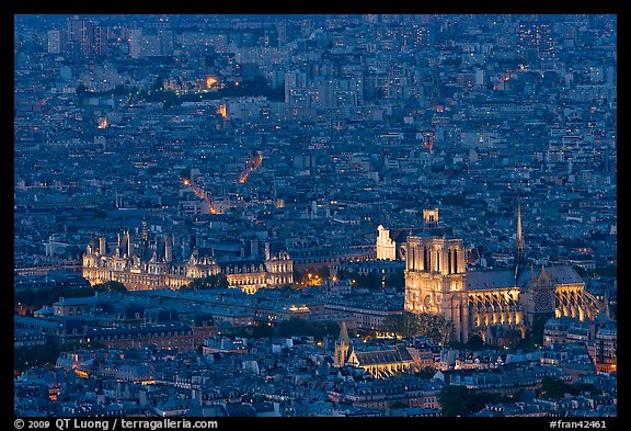 Aerial night view with Notre-Dame and Hotel de Ville. Paris, France