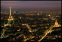 Aerial view at night with Eiffel Tower, Invalides, and Arc de Triomphe. Paris, France