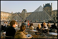 Cafe terrace in the Louvre main courtyard with glass pyramid. Paris, France (color)