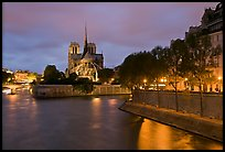 Banks of the Seine River, Ile de la Cite, Ile Saint Louis, and Notre Dame at twilight. Paris, France