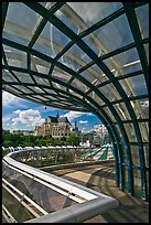 Curvy glass and metal structure framing historic Saint-Eustache church. Paris, France (color)