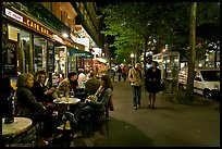 Cafe bar on sidewalk of a Grand Boulevard at night. Paris, France
